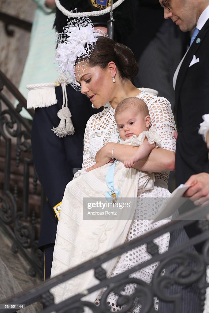 <a gi-track='captionPersonalityLinkClicked' href=/galleries/search?phrase=Crown+Princess+Victoria+of+Sweden&family=editorial&specificpeople=160266 ng-click='$event.stopPropagation()'>Crown Princess Victoria of Sweden</a> holds Prince Oscar, Duke of Skane after the ceremony at Royal Palace of Stockholm for the Christening of Prince Oscar of Sweden on May 27, 2016 in Stockholm, Sweden.
