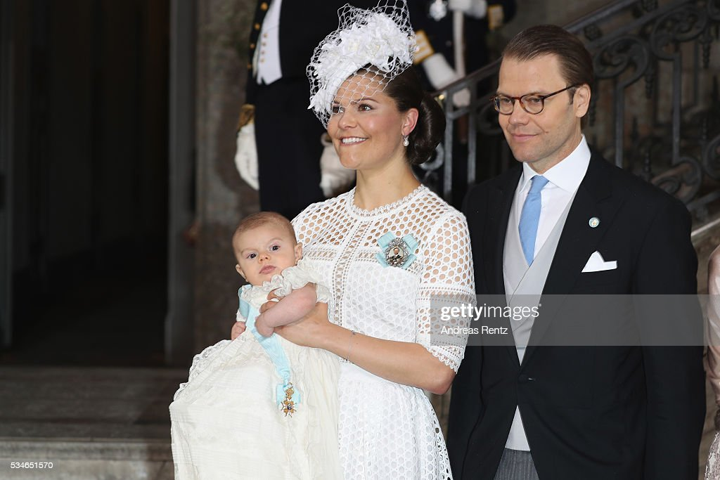 Crown Princess Victoria of Sweden holds Prince Oscar, Duke of Skane and Prince Daniel, Duke of Vastergotland are seen after the christening of Prince Oscar of Sweden at Royal Palace of Stockholm on May 27, 2016 in Stockholm, Sweden.