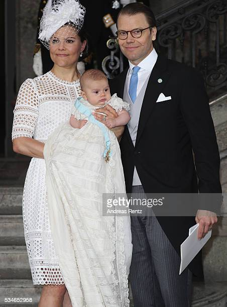 Crown Princess Victoria of Sweden holds Prince Oscar Duke of Skane and Prince Daniel Duke of Vastergotland are seen after the christening of Prince...