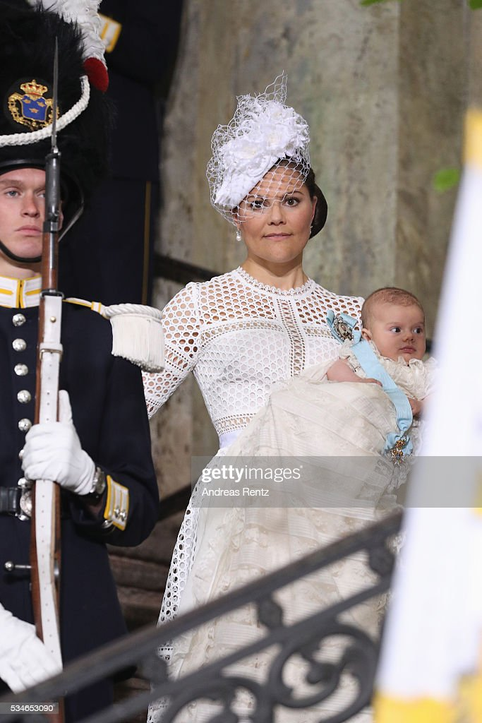 Crown Princess Victoria of Sweden holds Prince Oscar, Duke of Skane after the christening of Prince Oscar of Sweden at Royal Palace of Stockholm on May 27, 2016 in Stockholm, Sweden.