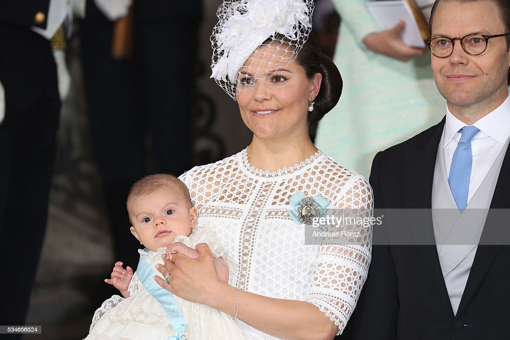 <a gi-track='captionPersonalityLinkClicked' href=/galleries/search?phrase=Crown+Princess+Victoria+of+Sweden&family=editorial&specificpeople=160266 ng-click='$event.stopPropagation()'>Crown Princess Victoria of Sweden</a> holds Prince Oscar, Duke of Skane and Prince Daniel, Duke of Vastergotland are seen after the christening of Prince Oscar of Sweden at Royal Palace of Stockholm on May 27, 2016 in Stockholm, Sweden.