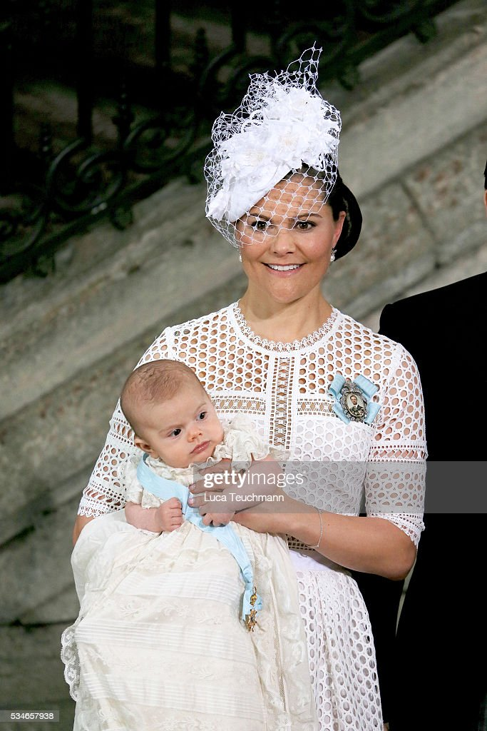 Crown Princess Victoria of Sweden holds Prince Oscar, Duke of Skane after the ceremony at The Royal Palace for the Christening of Prince Oscar of Sweden on May 27, 2016 in Stockholm, Sweden.