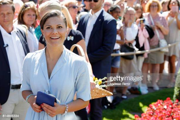 Crown Princess Victoria of Sweden is seen meeting the people gathered in front of Solliden Palace to celebrate the 40th birthday of Crown Princess...