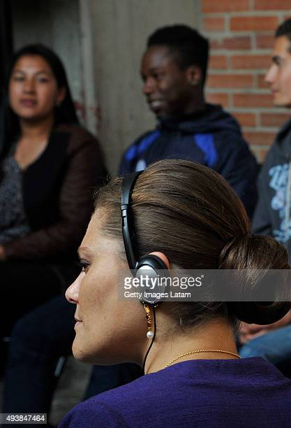Crown Princess Victoria of Sweden listens to a group of youngsters during a visit to the enterprise driven project 'Ruta Motor' on October 22 2015 in...