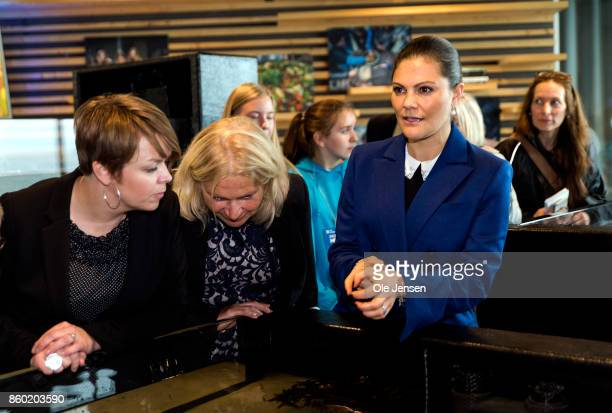 Crown Princess Victoria of Sweden looks at a marine life basin at the new Marine Pedagogical Learning Center after she attended the Life Below Water...