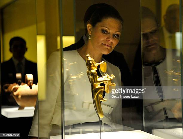 Crown Princess Victoria of Sweden looks at a prehispanic gold piece during a visit to the Gold Museum on October 23 2015 in Bogota Colombia