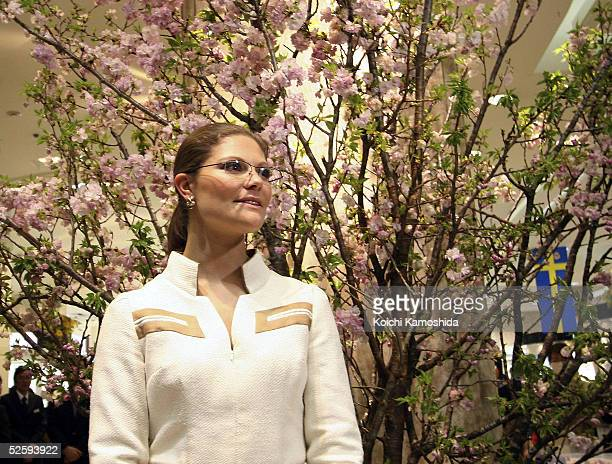 Crown Princess Victoria of Sweden looks at cherry blossom displayed at Matsuzakaya department store on April 6 2005 in Nagoya Japan She is in Japan...