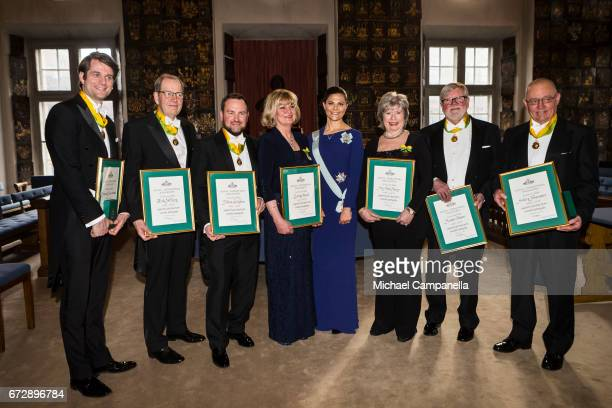 Crown Princess Victoria of Sweden poses for a picture with the winners of the Royal Patriotic Society's annual prize during an annual event at...