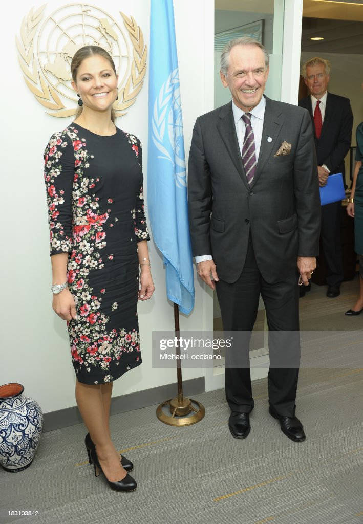 Crown Princess Victoria of Sweden poses with UN Deputy Secretary General <a gi-track='captionPersonalityLinkClicked' href=/galleries/search?phrase=Jan+Eliasson&family=editorial&specificpeople=563205 ng-click='$event.stopPropagation()'>Jan Eliasson</a> during her visit to the United Nations at the United Nations on October 4, 2013 in New York City.