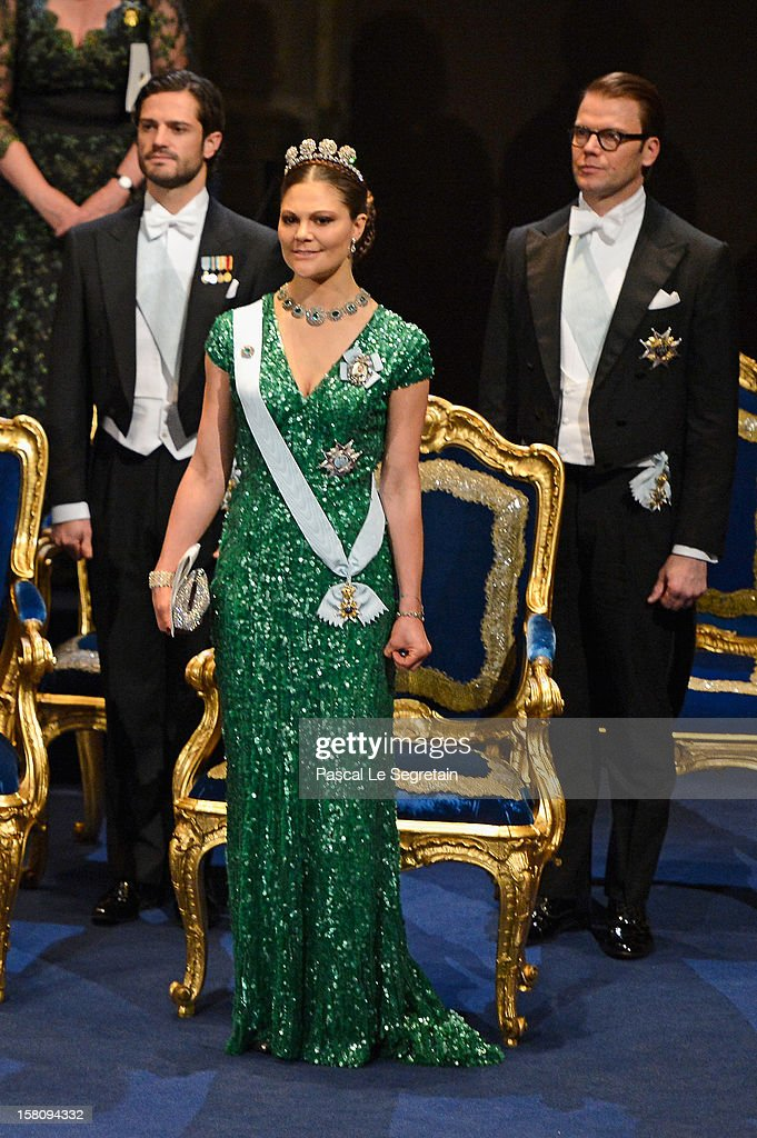 Crown Princess Victoria of Sweden (C), Prince Carl Philip of Sweden (L) and Prince Daniel of Sweden attend the Nobel Prize Ceremony at Concert Hall on December 10, 2012 in Stockholm, Sweden.