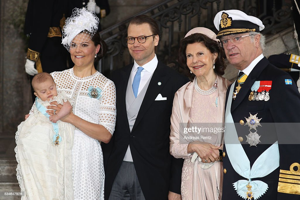 Crown Princess Victoria of Sweden, Prince Oscar of Sweden, Prince Daniel of Sweden, Queen Silvia Of Sweden and King Carl Gustaf of Sweden are seen at Royal Palace of Stockholm for the Christening of Prince Oscar of Sweden on May 27, 2016 in Stockholm, Sweden.