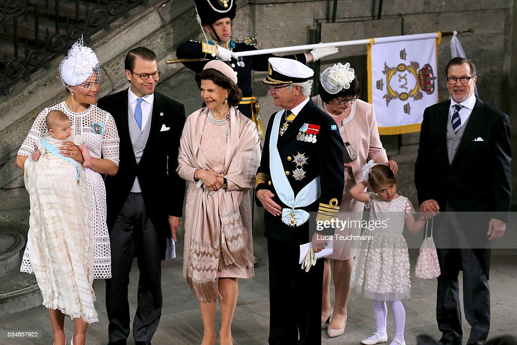 Crown Princess Victoria of Sweden, Prince Oscar of Sweden, Prince Daniel of Sweden, Queen Silvia Of Sweden and King Carl Gustaf of Sweden are seen at The Royal Palace for the Christening of Prince Oscar of Sweden on May 27, 2016 in Stockholm, Sweden.