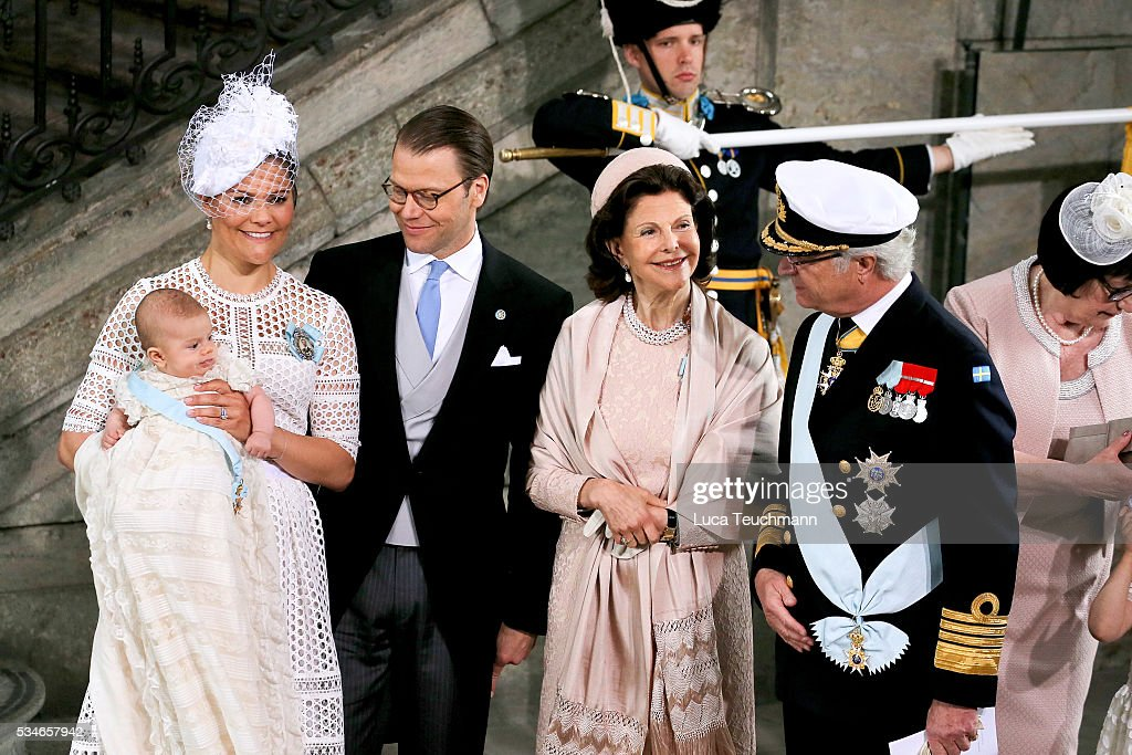 <a gi-track='captionPersonalityLinkClicked' href=/galleries/search?phrase=Crown+Princess+Victoria+of+Sweden&family=editorial&specificpeople=160266 ng-click='$event.stopPropagation()'>Crown Princess Victoria of Sweden</a>, Prince Oscar of Sweden, Prince Daniel of Sweden, Queen Silvia Of Sweden and King Carl Gustaf of Sweden are seen at The Royal Palace for the Christening of Prince Oscar of Sweden on May 27, 2016 in Stockholm, Sweden.
