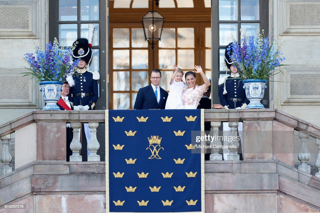 Crown Princess Victoria of Sweden, Princess Estelle of Sweden and Prince Daniel of Sweden wave to fans waiting outside the Royal Palace for Princess Victoria of Sweden's 40th birthday celebrations at the Royal Palace on July 14, 2017 in Stockholm, Sweden. The celebrations in Stockholm end with the Crown Princess Family being escorted from the Royal Palace to the Royal Stables in a horse drawn carriage.
