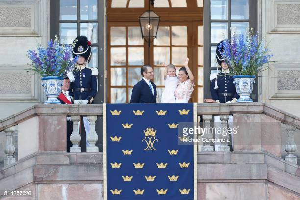 Crown Princess Victoria of Sweden Princess Estelle of Sweden and Prince Daniel of Sweden wave to fans waiting outside the Royal Palace for Princess...