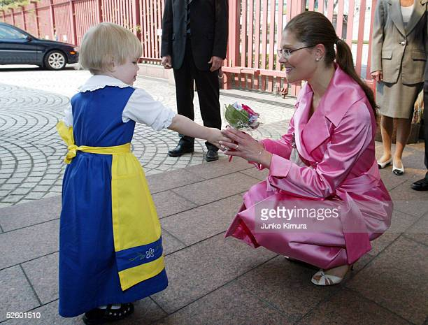 Crown Princess Victoria of Sweden receives flowers from Matilda Sundberg a 2yearold Swedish girl living in Japan upon her arrival at the Swedish...