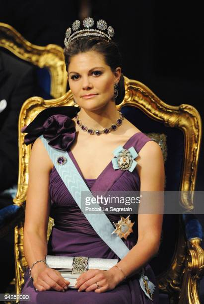 Crown Princess Victoria of Sweden sits on stage during the Nobel Foundation Prize Awards Ceremony 2009 at the Concert Hall on December 10 2009 in...