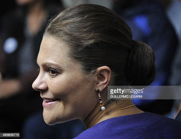 Crown Princess Victoria of Sweden smiles during a visit to the Ruta Motor project a social program sponsored by the Swedish government to help...
