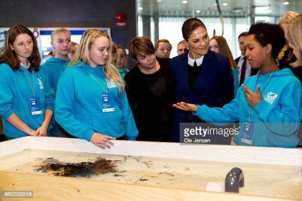 Crown Princess Victoria of Sweden speaks to young students about one of the marine life basin at the new Marine Pedagogical Learning Center after she...