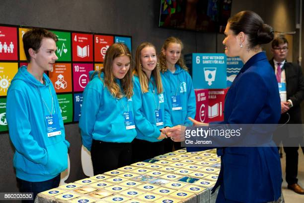 Crown Princess Victoria of Sweden speaks to young students at the new Marine Pedagogical Learning Center after she attended the Life Below Water...