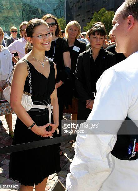 Crown Princess Victoria of Sweden stops during a tour of the Swedish Style exhibition at Federation Square in Melbourne 11 March 2005 to speak with...