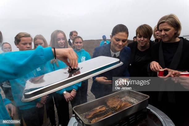 Crown Princess Victoria of Sweden taste fish which have been caught prepared and cooked by young students at the new Marine Pedagogical Learning...