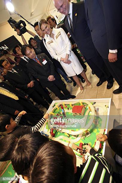 Crown Princess Victoria of Sweden watches children play with a game at Matsuzakaya department store on April 6 2005 in Nagoya Japan She is in Japan...
