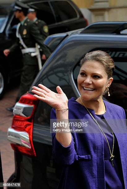 Crown Princess Victoria of Sweden waves as she walks down a street of downtown Bogota after holding a private meeting with Colombia's president Juan...