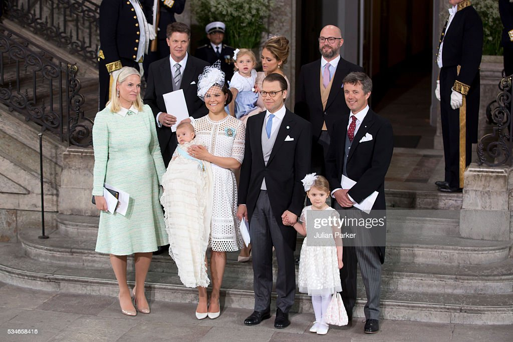 <a gi-track='captionPersonalityLinkClicked' href=/galleries/search?phrase=Crown+Princess+Victoria+of+Sweden&family=editorial&specificpeople=160266 ng-click='$event.stopPropagation()'>Crown Princess Victoria of Sweden</a>, with Prince Oscar of Sweden, and Prince Daniel of Sweden, with god parents, and the christening group,attend the christening of Prince Oscar of Sweden at the Royal Palace in Stockholm on May 27, 2016 in Stockholm, Sweden.