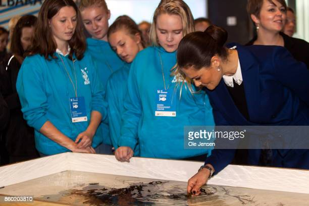 Crown Princess Victoria speaks to young students about one of the marine life basin at the new Marine Pedagogical Learning Center on October 11 2017...
