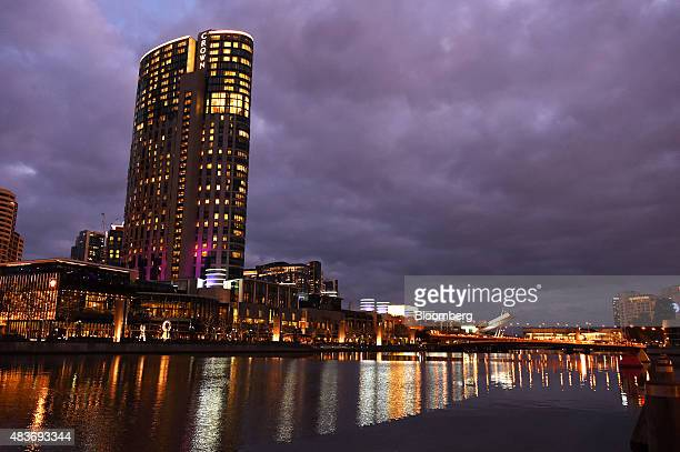 Crown Resorts Ltd's Crown Towers hotel part of the Crown Melbourne casino and entertainment complex stands along the Yarra River at dusk in Melbourne...