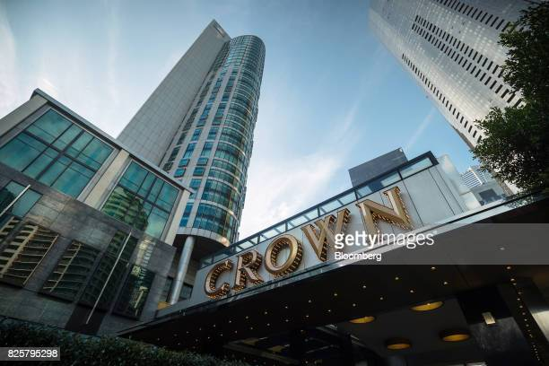 Crown Resorts Ltd's Crown Towers hotel part of the Crown Melbourne casino and entertainment complex left stands in Melbourne Australia on Wednesday...