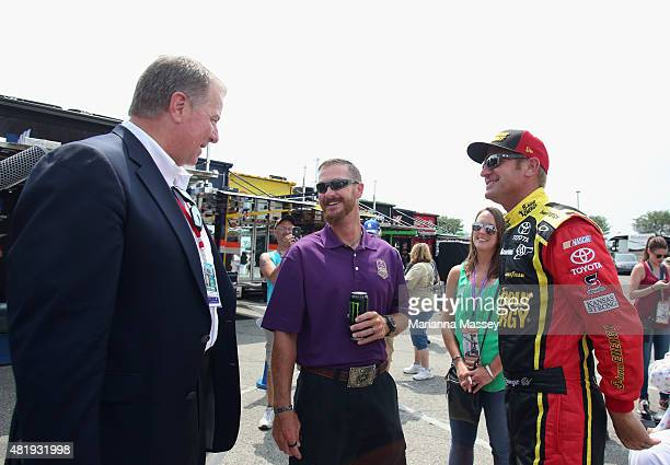 Crown Royal 'Your Hero's Name Here' winner and Brickyard 400 race namesake Jeff Kyle interacts with Indianapolis Motor Speedway representative Jay...