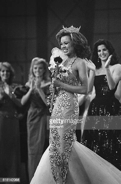 Crowned the new Miss America 1984 Miss New York Vanessa L Williams beams as she is applauded by runnersup Miss Virginia Lisa Aliff and Miss Ohio...