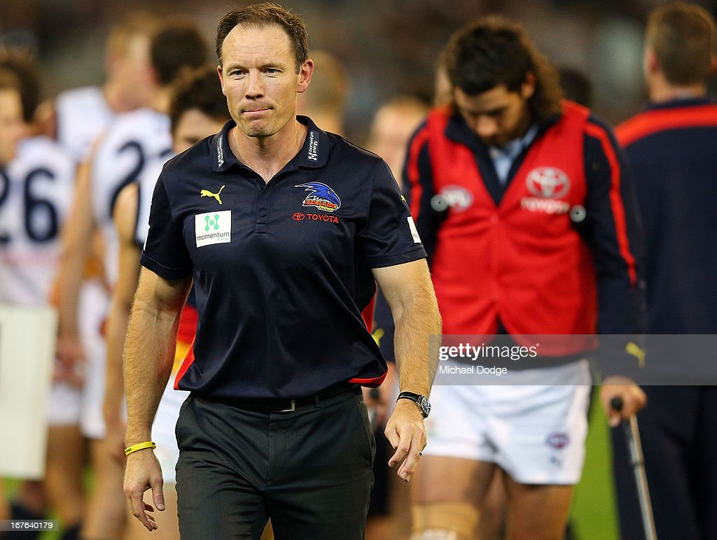 Crows coach <a gi-track='captionPersonalityLinkClicked' href=/galleries/search?phrase=Brenton+Sanderson&family=editorial&specificpeople=224964 ng-click='$event.stopPropagation()'>Brenton Sanderson</a> looks ahead with Taylor Walker behind him on crutches after injuring his leg during the round five AFL match between the Carlton Blues and the Adelaide Crows at Melbourne Cricket Ground on April 27, 2013 in Melbourne, Australia.
