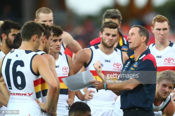 Crows coach Don Pyke talk to players during the round five AFL match between the Gold Coast Suns and the Adelaide Crows at Metricon Stadium on April...
