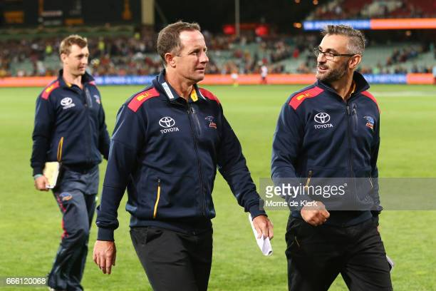 Crows head coach Don Pyke and assistant coach Scott Camporeale leave the field after during the round three AFL match between the Port Adelaide Power...