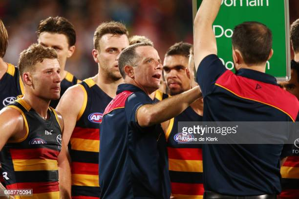 Crows head coach Don Pyke speaks to his team during the round four AFL match between the Adelaide Crows and the Essendon Bombers at Adelaide Oval on...