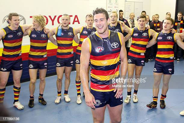 Crows players celebrate after the game with new player Kyle Hartigan after the round 22 AFL match between the Adelaide Crows and the Melbourne Demons...