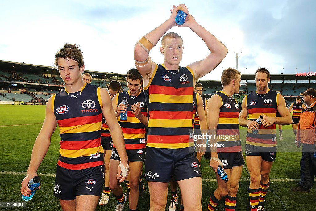 Crows players celebrate as they leave the field after the round 17 AFL match between the Adelaide Crows and the Geelong Cats at AAMI Stadium on July 21, 2013 in Adelaide, Australia.