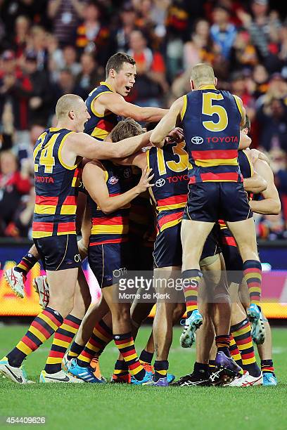 Crows players celebrate with Ben Rutten after he kicked a goal during the round 23 AFL match between the Adelaide Crows and the St Kilda Saints at...
