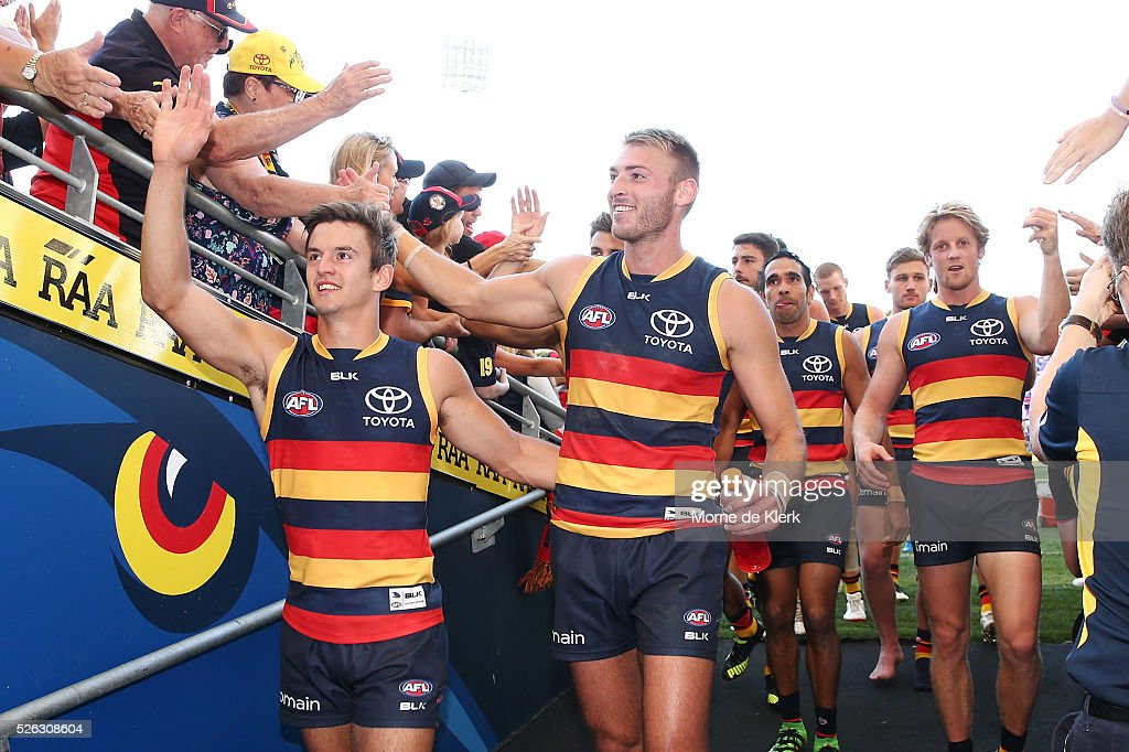 Crows players come from the field after winning the round six AFL match between the Adelaide Crows and the Fremantle Dockers at Adelaide Oval on April 30, 2016 in Adelaide, Australia.