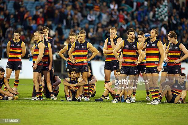 Crows players react after the round 19 AFL match between the Adelaide Crows and Port Adelaide Power at AAMI Stadium on August 4 2013 in Adelaide...