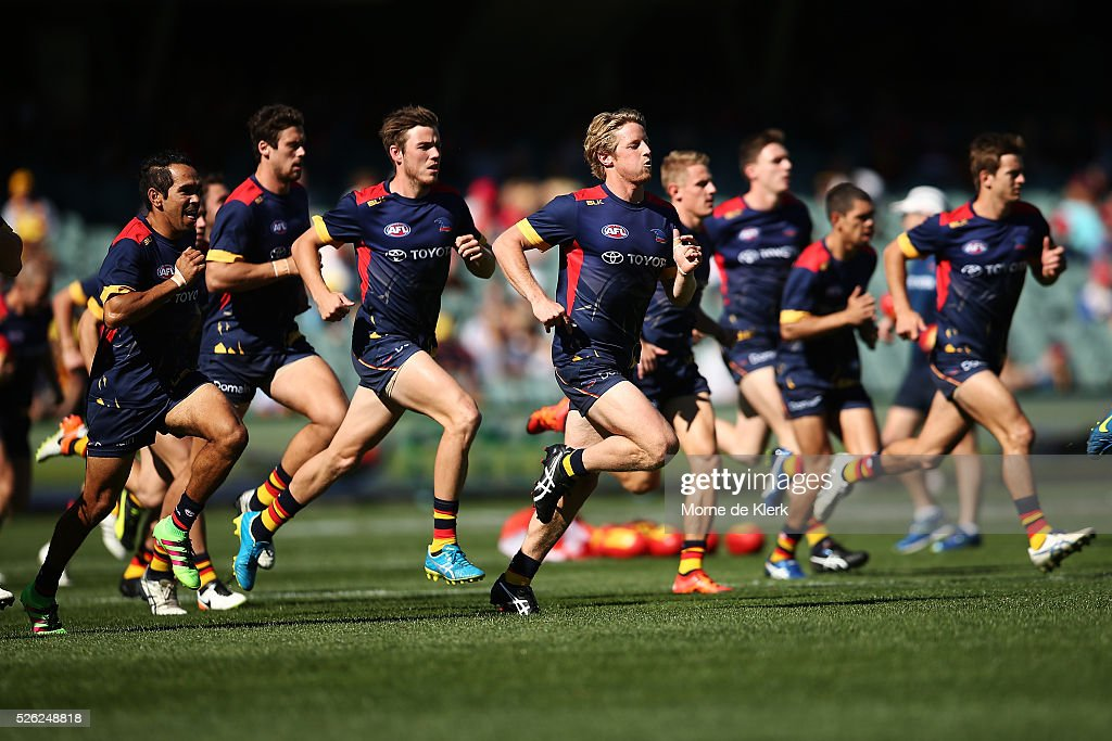 Crows players warm up before the round six AFL match between the Adelaide Crows and the Fremantle Dockers at Adelaide Oval on April 30, 2016 in Adelaide, Australia.