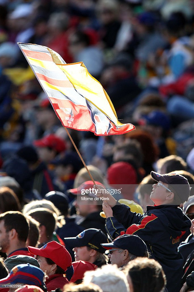 A Crows supporter flies his team flag during the round three AFL match between the Adelaide Crows and the Fremantle Dockers at AAMI Stadium on April 9, 2011 in Adelaide, Australia.