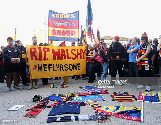 Crows supporters create a shrine of remembrance to the late Phil Walsh at Adelaide Oval on July 5 2015 in Adelaide Australia Adelaide Crows AFL coach...