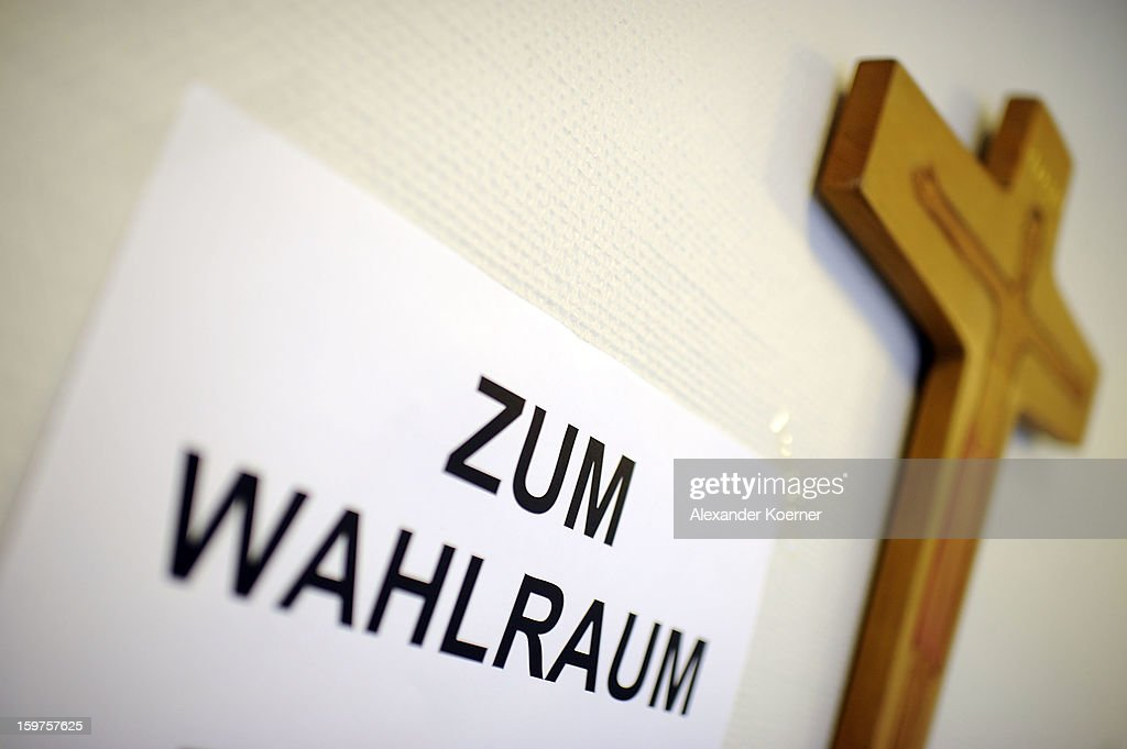 A crucifix is fixed to a wall beside a sign at a polling station during the Lower Saxony eletions on January 20, 2013 in Hanover, Germany. The elections are being seen by many as a strong indicator for the general elections scheduled for later this year.