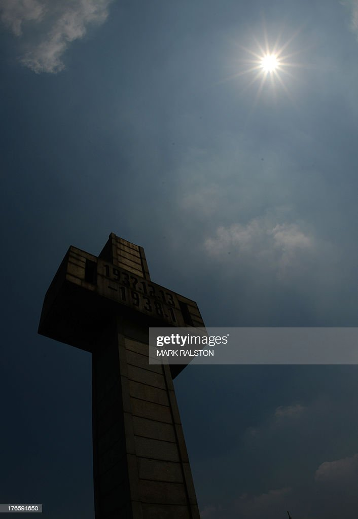 A crucifix is pictured at the Nanjing Massacre Memorial Museum in Nanjing on August 16, 2013. Japan's conservative prime minister on August 15 broke with two decades of tradition by omitting any expression of remorse over the country's past aggression in Asia on the anniversary of its World War II surrender. Shinzo Abe's speech, which came after nearly 100 lawmakers including two cabinet ministers visited a controversial war shrine -- avoided typical words such as 'profound remorse' and 'sincere mourning' used by his predecessors to atone for those who suffered as the Imperial Japanese Army stormed across East Asia. AFP PHOTO / Mark RALSTON