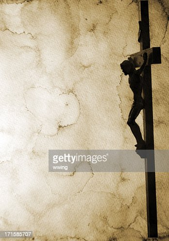 Crucifix on Stained Paper with lots of copy space