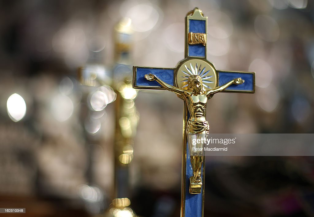 Crucifixes are displayed for sale near Vatican City on February 24, 2013 in Rome, Italy. The Pontiff will hold his last weekly public audience on February 27, 2013 before he retires the following day. Pope Benedict XVI has been the leader of the Catholic Church for eight years and is the first Pope to retire since 1415. He cites ailing health as his reason for retirement and will spend the rest of his life in solitude away from public engagements.